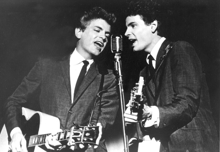 Phil Everly, left, performs with his brother Don Everly in 1964.