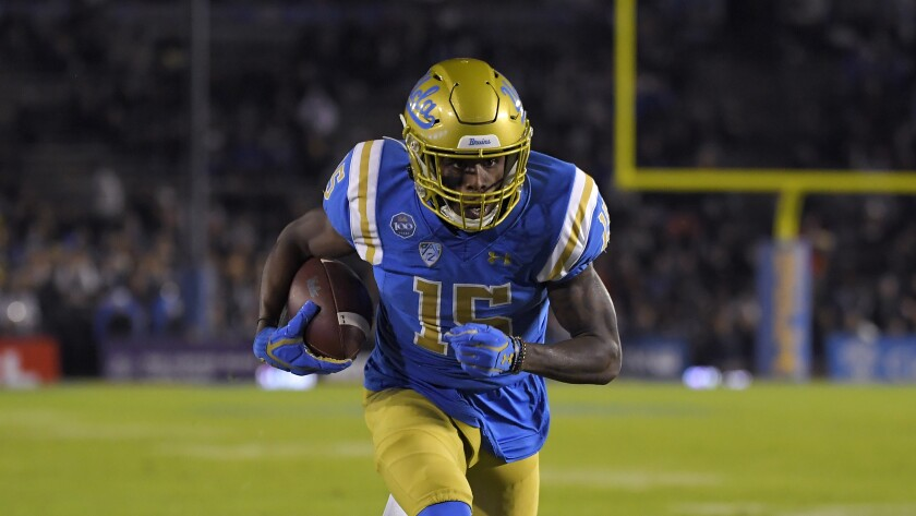 UCLA wide receiver Jaylen Erwin heads toward the end zone for a score against California.