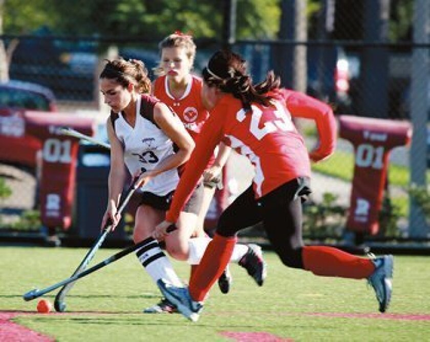 Megan Watson tries to break through with the ball. Photo: Brittany Comunale