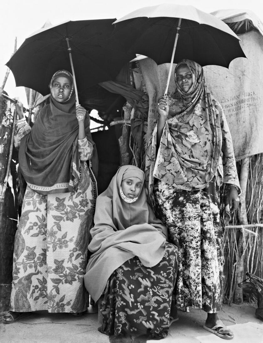 "(L-R)- A photograph featured in the book ""Human Archipelago."" Shamso, Zahara, and Alima, Somali refu"