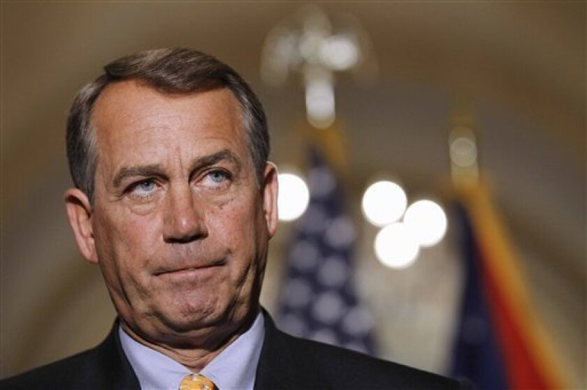 FILE - In this April 1, 2011, file photo House Speaker John Boehner of Ohio pauses during a news conference on Capitol Hill in Washington. President Barack Obama is summoning key lawmakers from both parties to the White House to help speed up budget negotiations and avoid a looming government shutdown at week's end. (AP Photo/Alex Brandon, File)
