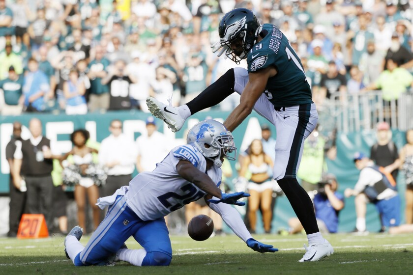 Philadelphia Eagles' J.J. Arcega-Whiteside, right, cannot catch a pass against Detroit Lions' Rashaan Melvin during the second half of an NFL football game, Sunday, Sept. 22, 2019, in Philadelphia. Detroit won 27-24. (AP Photo/Michael Perez)
