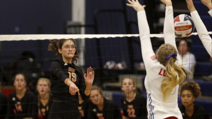 Sabrina Phinizy (19) scores for Huntington Beach High during the second set of a Surf League match at Los Alamitos on Wednesday.