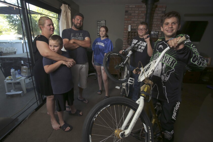 Darek Smith, 14, on a BMX bike at far right, with his family.