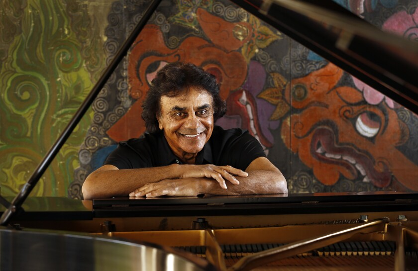 Legendary singer Johnny Mathis at his Hollywood Hills home, which was damaged in a fire Monday evening, authorities said.