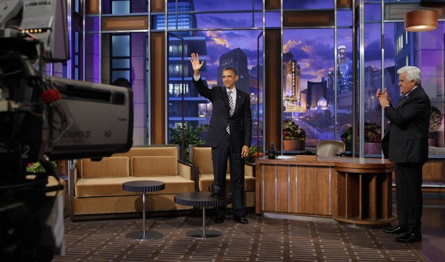"""President Obama waves to the studio audience on """"The Tonight Show"""" set."""