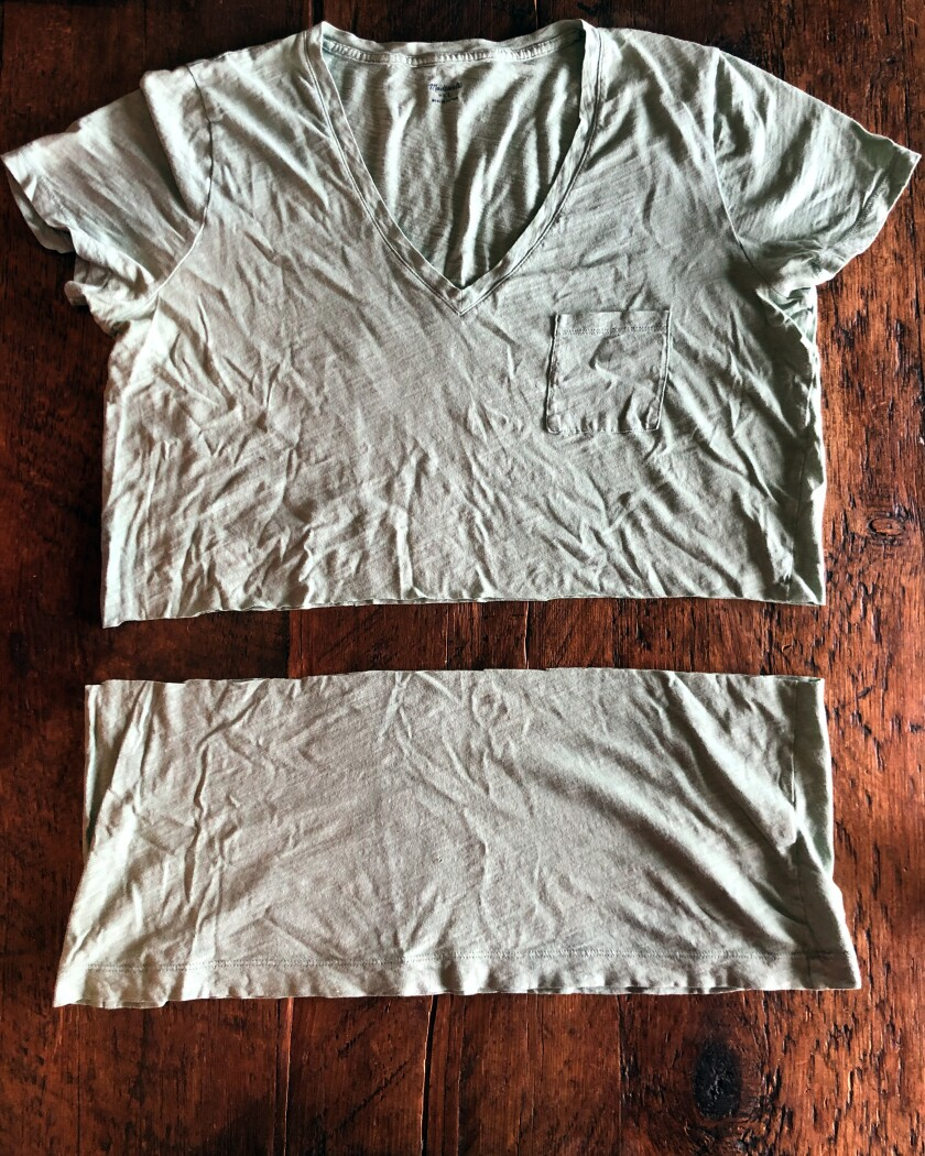A cotton T-shirt can be cut and worn as a mask to slow the spread of COVID-19.