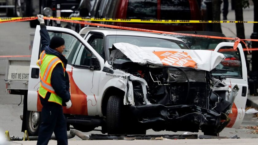 A damaged Home Depot truck remains on the scene after the driver mowed down people on a riverfront bike path near the World Trade Center on Tuesday in New York.