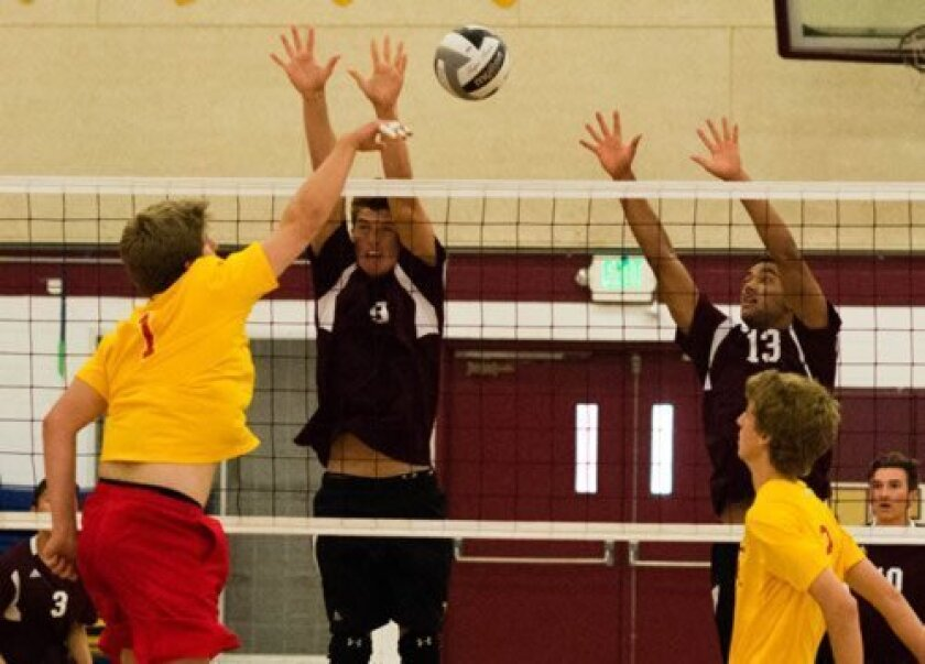 Bishop's Noah Fales and Chris Alleyne (13) defend against the Cathedral Catholic High Dons. Ed Piper