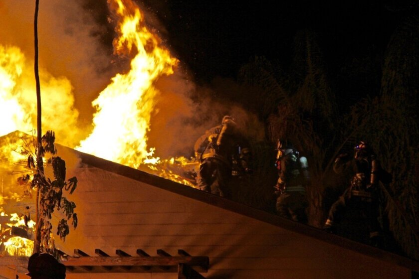 A fire that spread from the garage to the attic of a home on Seasons Road in Oceanside caused extensive damage Saturday, but no injuries.