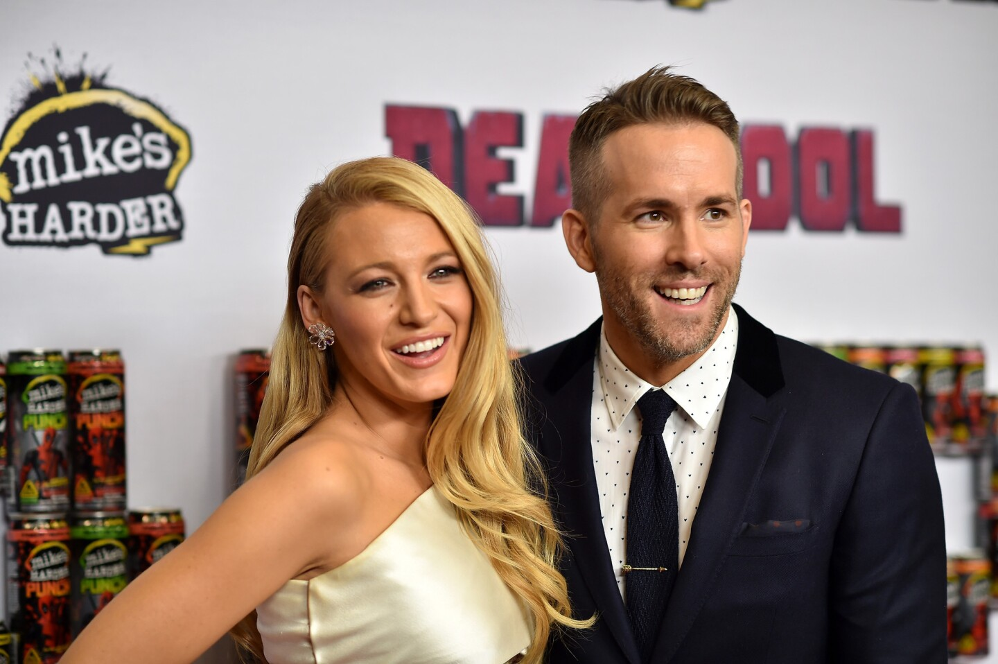 """Actors Blake Lively, left, and Ryan Reynolds attend a """"Deadpool"""" fan event at AMC Empire Theatre on Feb. 8, 2016 in New York City ahead of the Marvel film's release."""
