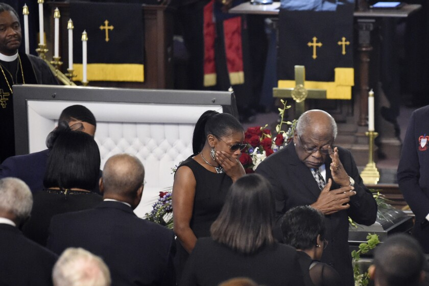 House Majority Whip Jim Clyburn, right, walks to his seat after pausing at the casket during the homegoing services for his wife Emily, Monday, Sept. 23, 2019, in Charleston, S.C. Democratic leaders and several presidential candidates attended two days of services for Emily Clyburn. (AP Photo/Meg Kinnard)