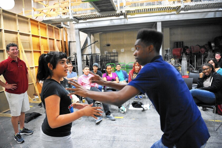 Actor Pat Finn, far left, watches as high school students Francis Arana and Jevonne Davis, right, participate in an improv class for 14 high school students at Loyola Marymount University on July 22, 2015.