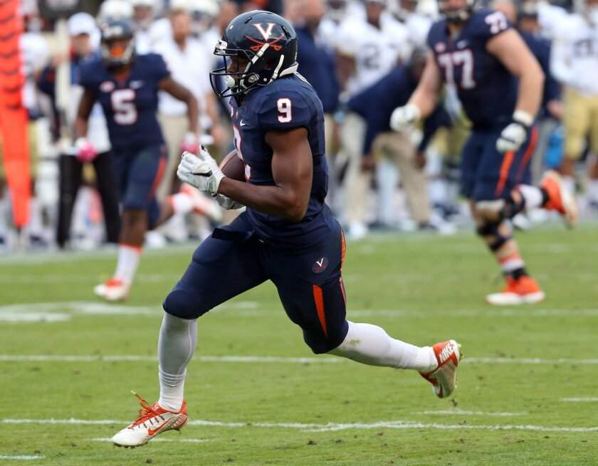 Virginia wide receiver Canaan Severin (9) catches a pass then runs it in for a touchdown during the second half of an ACC college football game against Georgia Tech at Scott Stadium, Saturday, Oct. 31, 2015, in Charlottesville, Va. (AP Photo/Andrew Shurtleff)