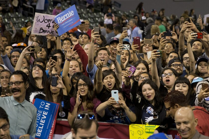 Supporters cheer for Democratic presidential candidate Sen. Bernie Sanders, I-Vt., during a rally on Tuesday, May 17, 2016, in Carson, Calif. (AP Photo/Jae C. Hong)