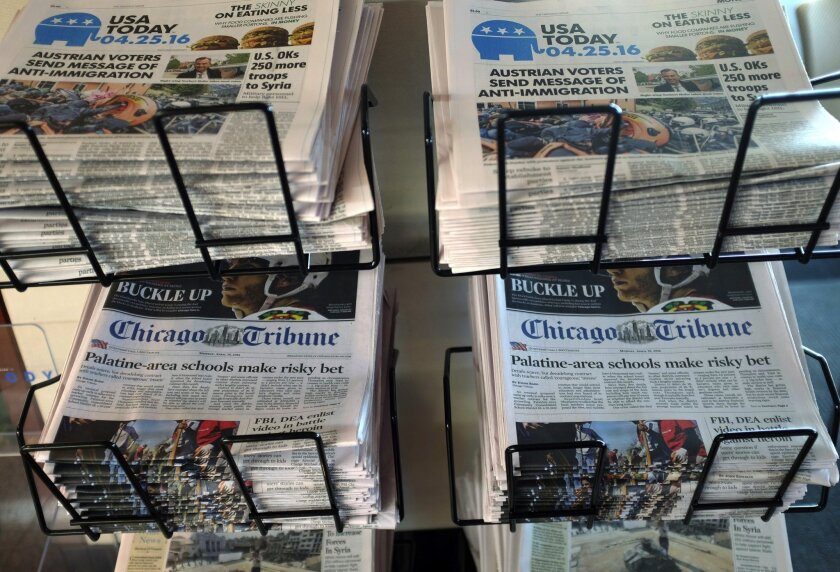 Newspapers for sale at O'Hare International Airport in Chicago. A study of people's physiological response to the news may explain why negative stories seem to dominate.