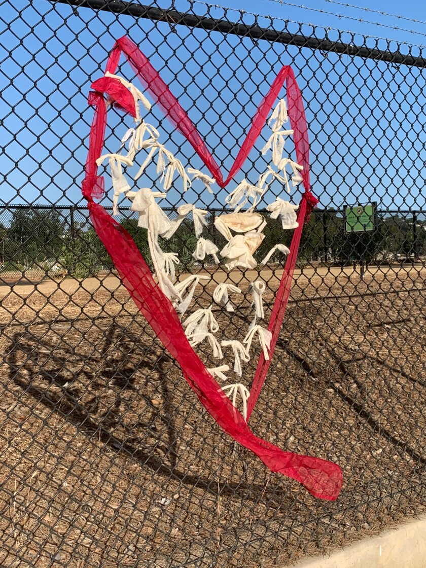 """A heart made of fabric is part of """"Say Their Names: Silver Lake Memorial."""""""
