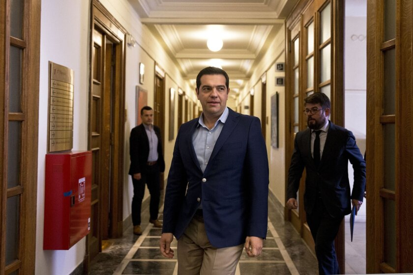 Greek Prime minister Alexis Tsipras arrives at a cabinet meeting on Thursday, June 2, 2016. Parliament approved a final round of austerity measures Thursday demanded by lenders for the release of further bailout loan installments. (AP Photo/Petros Giannakouris)