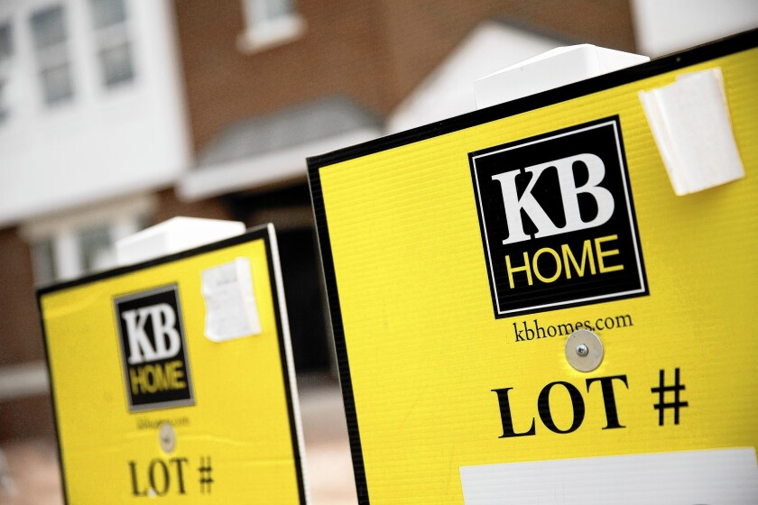 KB Home signs are shown outside condominiums under construction at the East Gate housing community in Chantilly, Va.