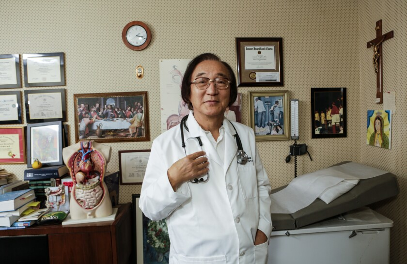 Dr. John Jae-dong Kim at his clinic in Upland. Kim is a Catholic deacon and gastroenterologist who is one of the organizers behind a Koreatown matchmaking event for parents with unmarried children.
