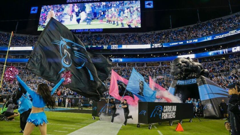 """The Carolina Panthers take the field before an Oct. 10 game against the Tampa Bay Buccaneers on 'Monday Night Football."""""""