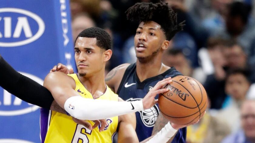 Lakers' Jordan Clarkson (6) looks to pass the ball as he is defended by Orlando Magic's Elfrid Payton during the second half on Wednesday.
