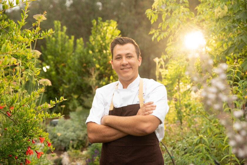 Chef de cuisine Christopher Gentile in the chef's garden at the Rancho Bernardo Inn. Gentile's menu is centered around produce grown in the resort's 3,000-square-foot garden.