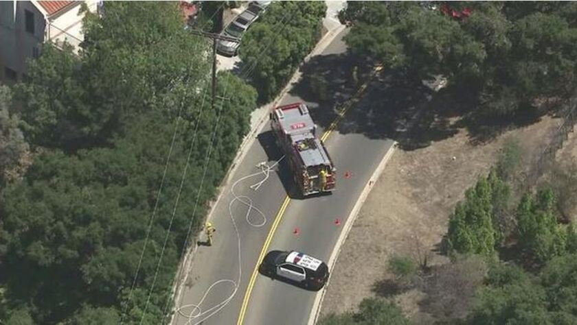 Los Angeles firefighters extinguished three small fires burning close together in the Beverly Crest neighborhood.