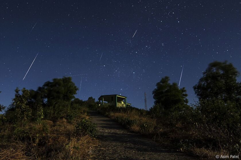 Streaks of light from the Geminid meteor showers.