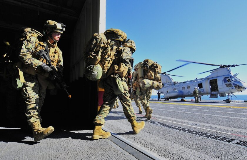 Last year during Exercise Iron Fist, 15th Marine Expeditionary Unit personnel boarded a CH-46 Sea Knight helicopter from the amphibious assault ship Peleliu. U.S. Navy/Petty Officer 2nd Class Michael Russell