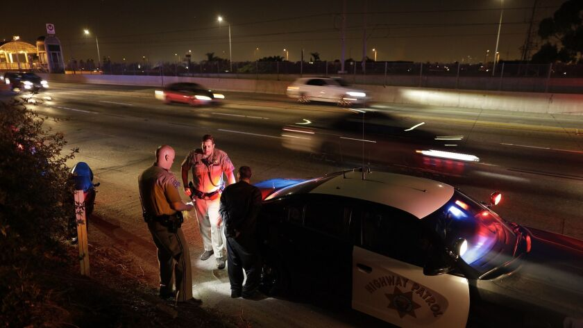 LOS ANGELES, CA -- JUNE 03, 2018: California Highway Patrol officers arrest a man who led officers o