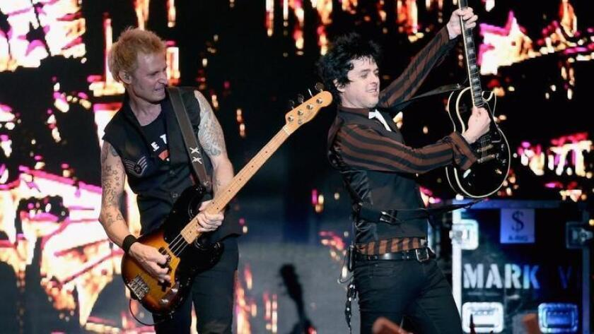 Green Day is shown in action at a December concert in Los Angeles. (Photo by Kevin Winter/Getty Images for CBS Radio)
