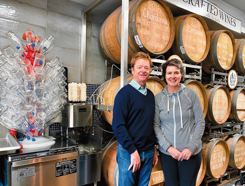 Owners Lowell and Anne Jooste stand between their barrels of craft wine and their growlers, ready to fill at LJ Crafted Wines, which is open 4-10 p.m. Monday-Thursday; 1-11 p.m. Friday-Saturday; and 2-8 p.m. Sunday at 5621 La Jolla Blvd., La Jolla. (858) 551-8890. ljcraftedwines.com
