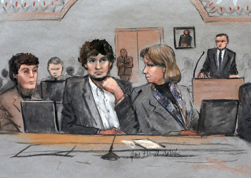A March 5 sketch shows Dzhokhar Tsarnaev, center, between defense attorneys Miriam Conrad, left, and Judy Clarke during his federal trial in Boston.
