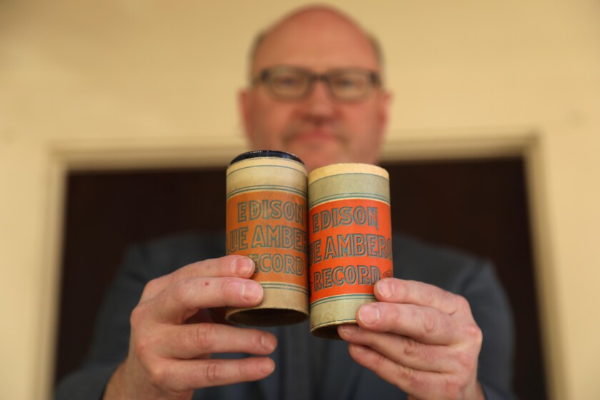 David Seubert of UCSB holds two rare Edison wax cylinders