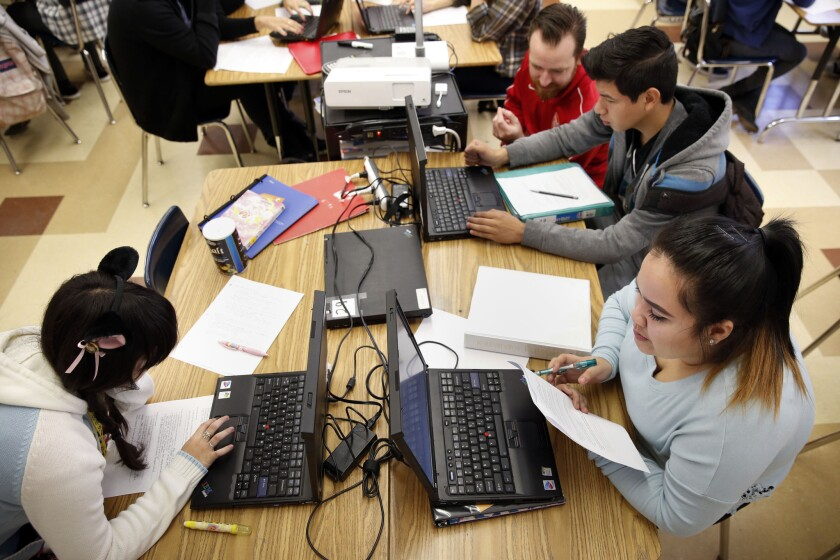 Eleventh-grade students work in a classroom at Francis Polytechnic High School in Sun Valley.