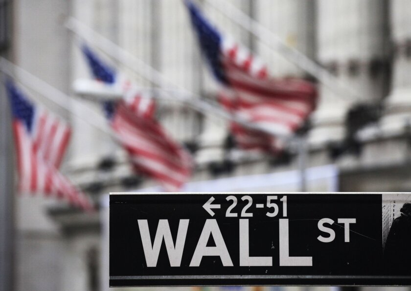 A sign marks Wall Street near the New York Stock Exchange.