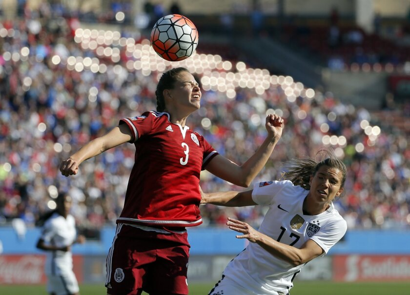 Mexico defender Ganelly Farias (3) heads away a corner kick by the United States as  U.S. midfielder Tobin Heath (17) pressures in the first half of a CONCACAF Olympic qualifying tournament soccer match, Saturday, Feb. 13, 2016, in Frisco, Texas. The U.S. won 1-0. (AP Photo/Tony Gutierrez)