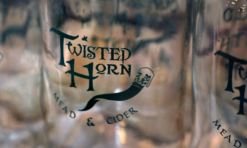 "The logo of Twisted Horn Mead & Cider is displayed on ""growlers"" waiting to be filled at the company's Vista location."