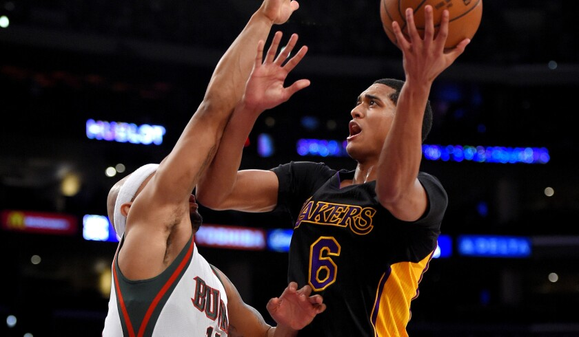 Point guard Jordan Clarkson, who led the Lakers with 16 points, attempts to score on a layup against Bucks guard Jerryd Bayless in the first half Friday night at Staples Center.