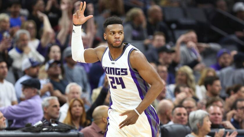 Sacramento Kings guard Buddy Hield (24) signals after hitting a three-point shot against the Memphis