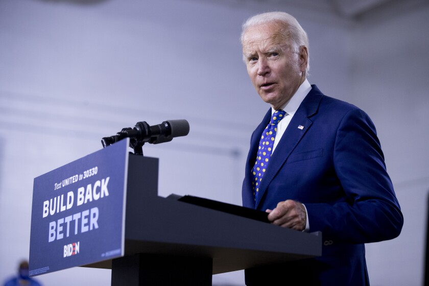 """FILE - In this July 28, 2020, file photo, Democratic presidential candidate former Vice President Joe Biden speaks at a campaign event at the William """"Hicks"""" Anderson Community Center in Wilmington, Del. Biden's campaign is reserving $280 million in digital and television ads through the fall, nearly twice the amount Donald Trump's team has reserved at this point. The Biden campaign announced in a Aug. 5 memo it's reserving $220 million on television airtime and $60 million in digital ads, in contrast to the $147 million the Trump campaign has reserved, according to a review of Kantar/CMAG data by the Associated Press.(AP Photo/Andrew Harnik, File)"""