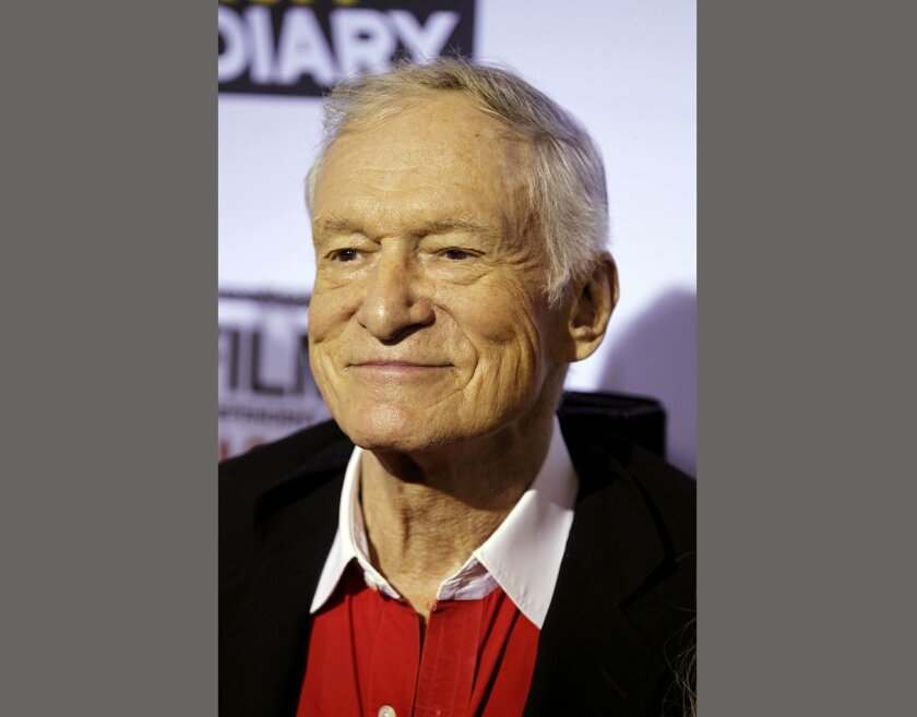 "FILE - In this Oct. 28, 2011 file photo, Hugh Hefner arrives at the premiere of ""The Rum Diary"" in Los Angeles. Attorney Gloria Allred said Friday, May 20, 2016, that Hefner gave sworn testimony at the Playboy Mansion on Wednesday in a case filed by Judy Huth claiming Bill Cosby sexually abused her at the Playboy Mansion around 1974 when she was 15 years old. (AP Photo/Matt Sayles, File)"