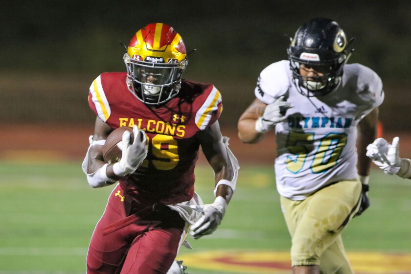 Torrey Pines running back Dorian Lewis, who scored the Falcons' only touchdown of the game, escapes Olympian defender Jonah Guerrero.