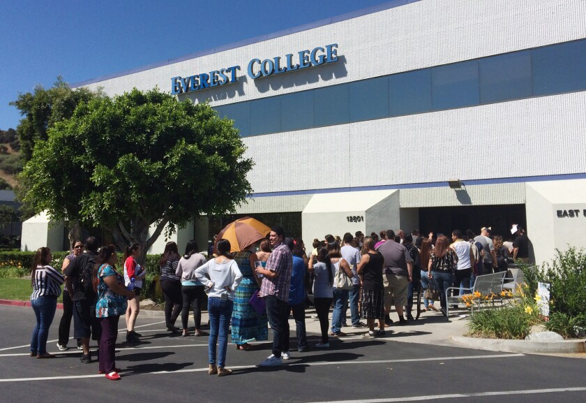 Students wait outside Everest College in City of Industry in April following the shutdown of Corinthian Colleges Inc. Students at California Everest and WyoTech campuses, along with some other schools, will receive expedited loan forgiveness based on findings from California Atty. Gen. Kamala Harris.