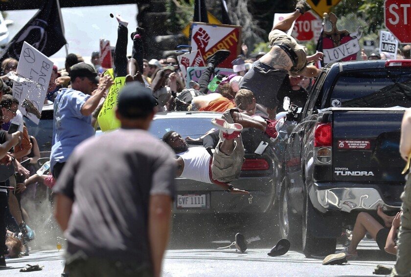 Some are thrown in the air as a car runs through a crowd of protesters at a 2017 white nationalist rally in Charlottesville, Va.