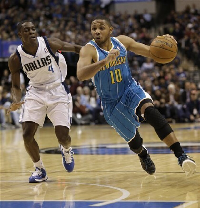 New Orleans Hornets shooting guard Eric Gordon (10) drives past Dallas Mavericks point guard Darren Collison (4) during the first half of an NBA basketball game Saturday, Jan. 5, 2013, in Dallas. (AP Photo/LM Otero)