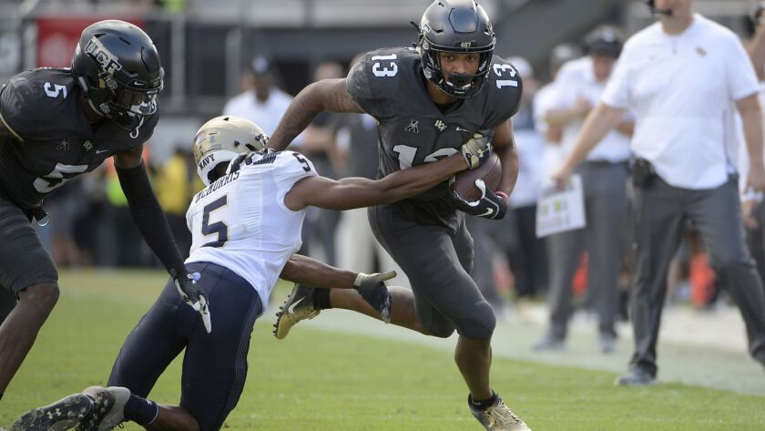 Central Florida wide receiver Gabriel Davis (13) runs after catching a pass in front of Navy defensi