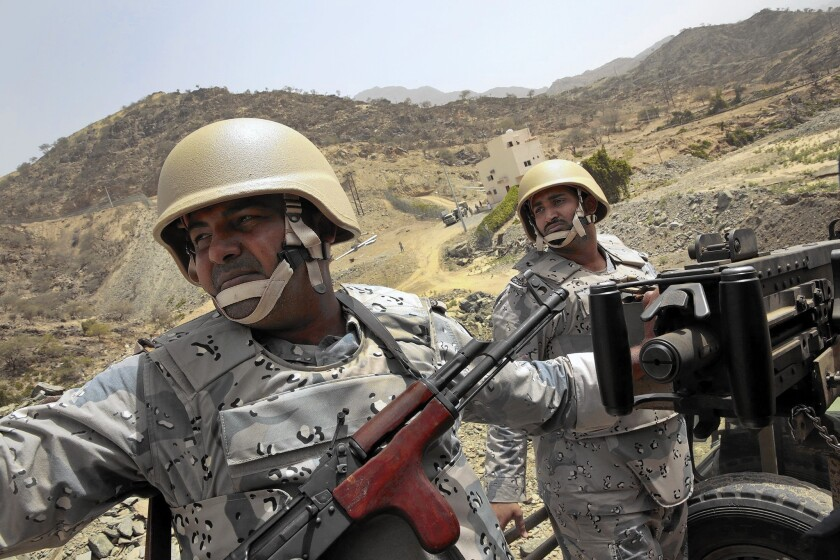 Saudi guards patrol near the town of Addayer, not far from the border with Yemen.