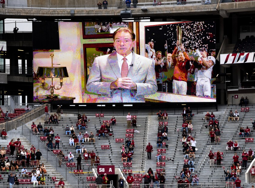 A prerecorded message from Alabama coach Nick Saban is shown on the big screen at Bryant-Denny Stadium before the Iron Bowl NCAA college football game between Alabama and Auburn on Saturday, Nov. 28, 2020, in Tuscaloosa, Ala. (Mickey Welsh/The Montgomery Advertiser via AP)